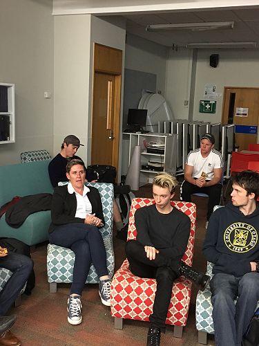 Rebs talking and Finn, Dion, David listening.