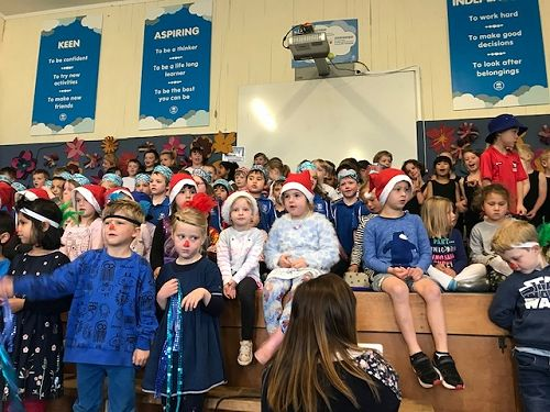The whole Junior School singing Christmas songs at our concert.