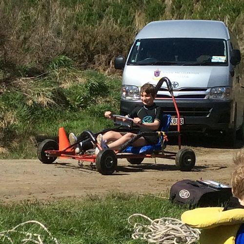 Tama steers his kart towards the pond
