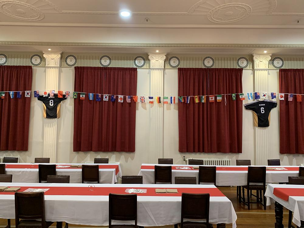 International flags and St Margaret's College football jerseys decorate the Dining Hall