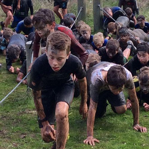 Matt leads the way on the mud run assault course