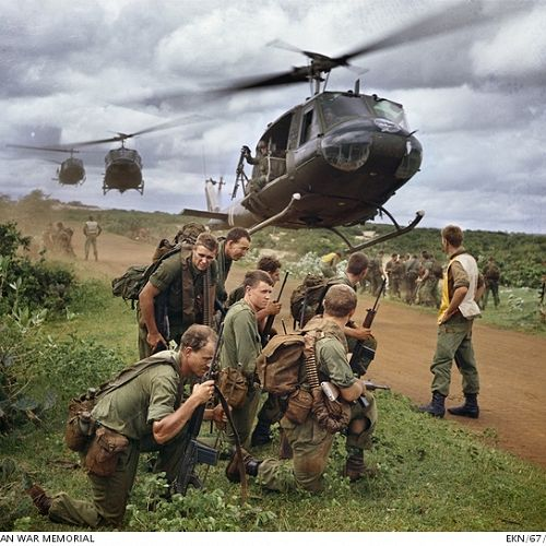 Australian soldiers waiting to be airlifted by Iroquois helicopters; Vietnam War, c. late 1960s.