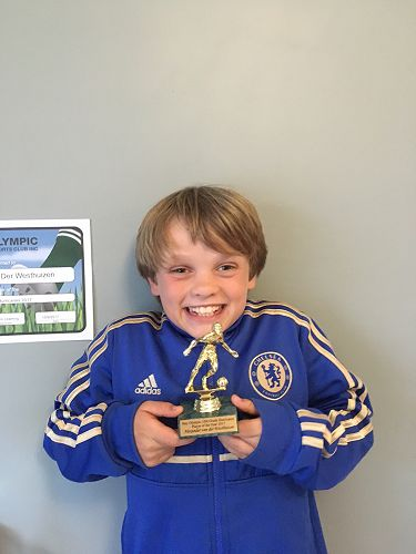 Alex with his trophy - very excited!