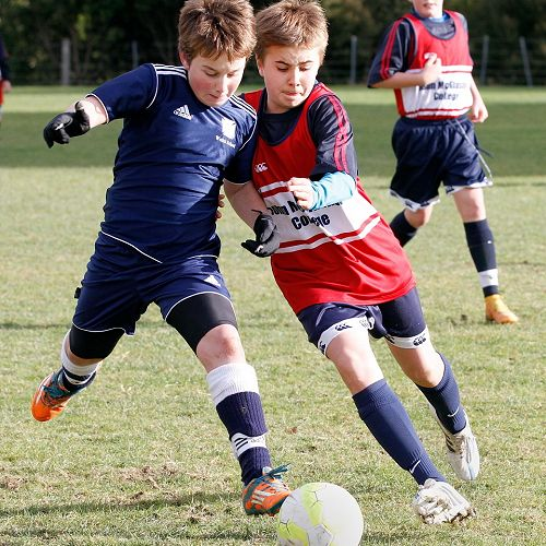 Sebastian Kyle fights for the ball in a centre-mid-field battle in the Waihi Exchange Football Game