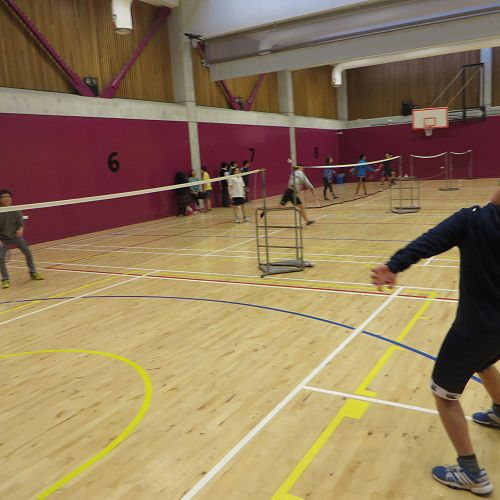 Jin Kim from JMC (right) playing badminton with some of the other students