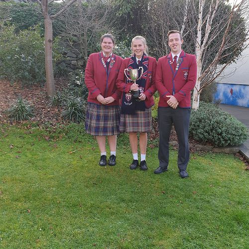 Left to right 2019 sports prefects Savannah Laws, Ashlee Middleton and Ambrose Lee , show off the 2019 Co-ED Sports Trophy Kavanagh College won for the 8th year in a row.