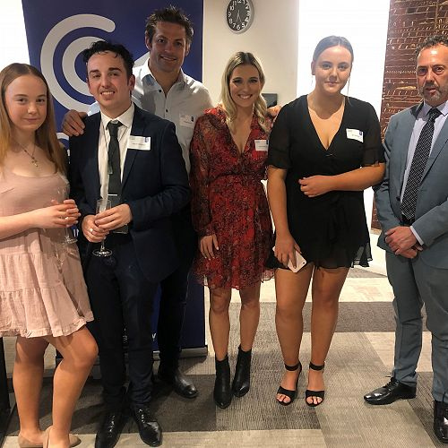 The first Chalky Carr Trust Scholar, former Shirley Boys and current UC Bachelor of Criminal Justice student Mario Williams (second from left), with Richie and Gemma McCaw (centre) and members of the Williams family.