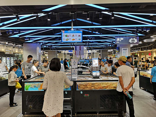 Shoppers in the Hema seafood showcase.
